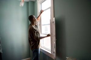 man opens a sash window
